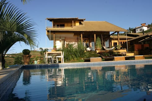 Residência LL: Piscinas tropicais por Mascarenhas Arquitetos Associados