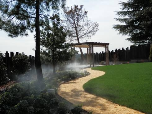 Cenador: Jardines de estilo moderno de ISAURA ROMEO ESTUDIO DE PAISAJISMO