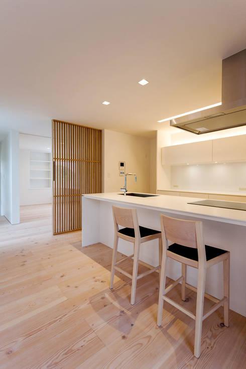 飯塚の住宅: MAアーキテクト一級建築士事務所が手掛けたキッチンです。