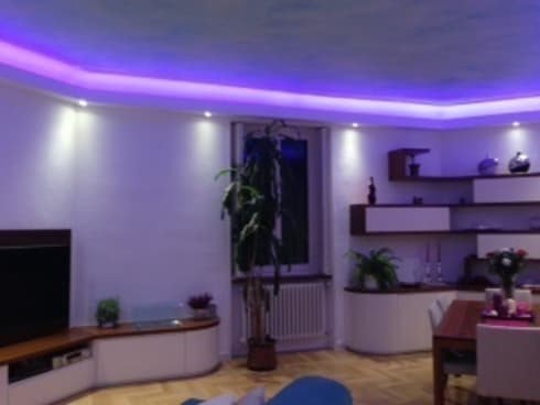 Giochi di luci nel soggiorno di studio design d 39 interni for Luci led a soffitto