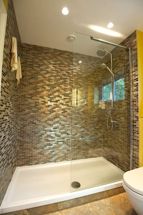 Walk in shower and feature tiling:  Bathroom by Chameleon Designs Interiors