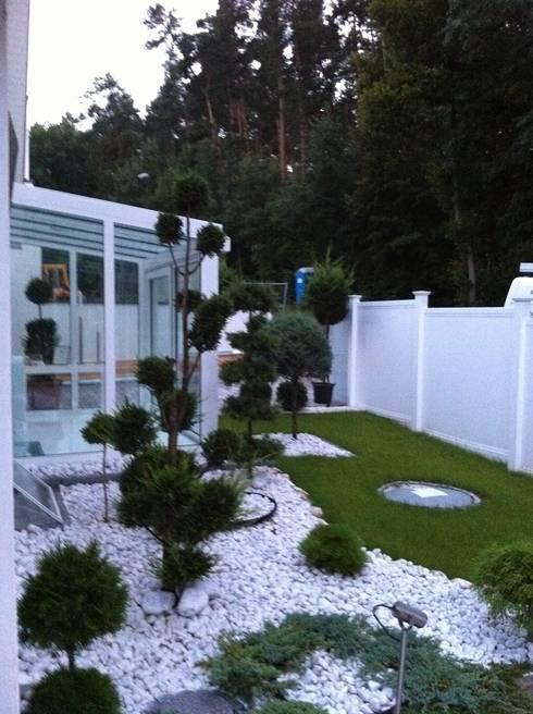 Jardines de estilo  por Ogrodzenia Radosław Sycz