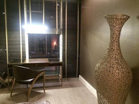 Interiorismo: Salas de estilo moderno por KAUS