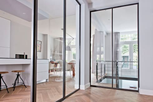 Benedenwoning te Amsterdam:  Gang en hal door Kodde Architecten bna