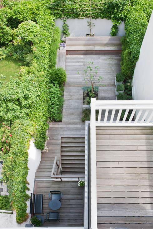Vernieuwbouw grachtenpand: moderne Tuin door Kodde Architecten bna