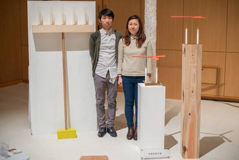 SPIN & WALL CANDLE: YOCHIYAが手掛けたリビングルームです。