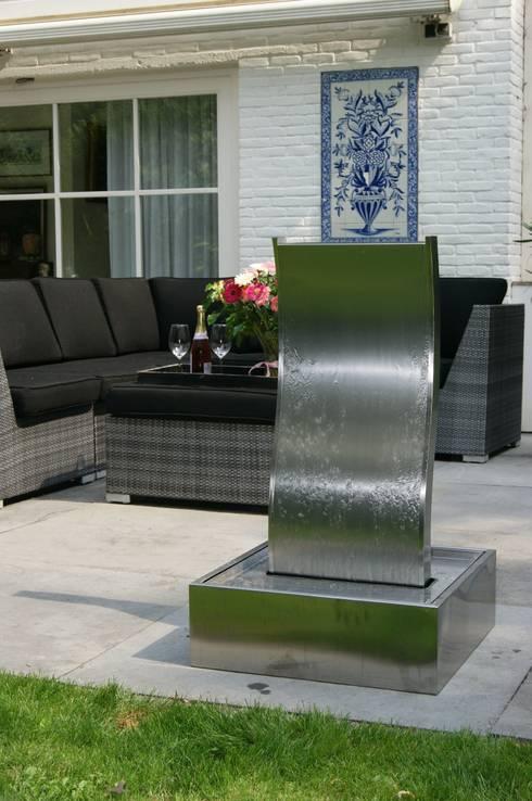 fontaine de jardin by janelabe homify. Black Bedroom Furniture Sets. Home Design Ideas