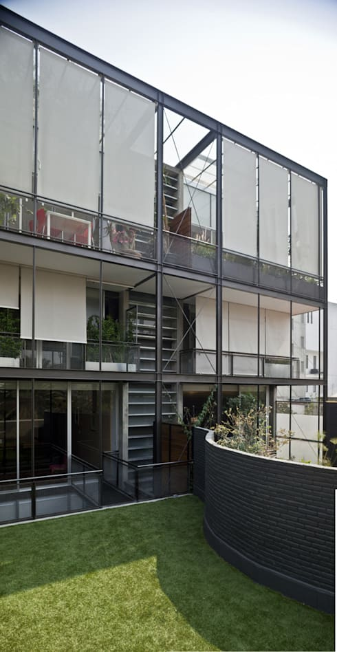 Edificio Teotihuacán: Casas de estilo minimalista por Cm2 Management