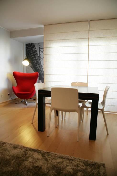 Sala Comum_Zona de refeições e leitura: Salas de jantar modernas por Traço Magenta - Design de Interiores
