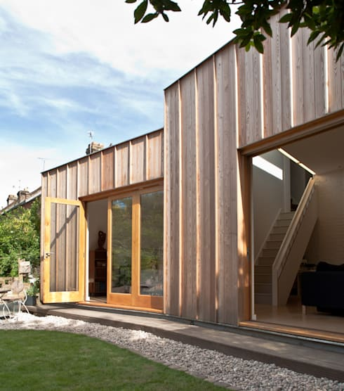 Angled rear elevation with doors open:  Houses by Neil Dusheiko Architects