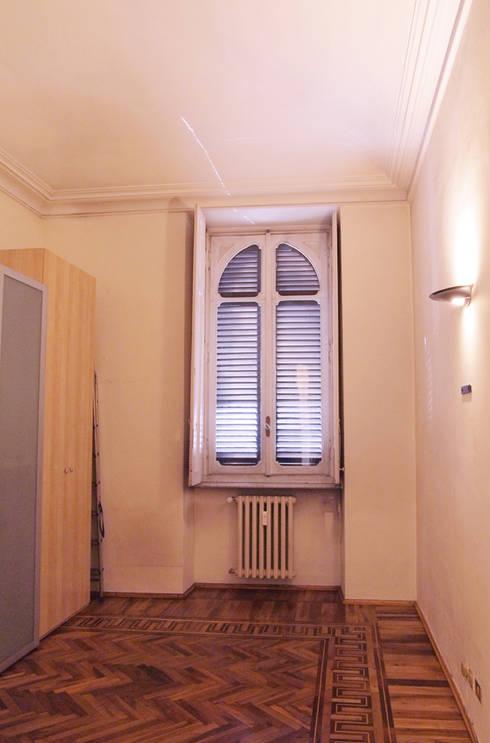Camera singola - prima:  in stile  di RE.DE.sign STUDIO