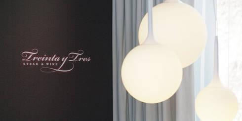 Restaurante: Espaços de restauração  por Traço Magenta - Design de Interiores