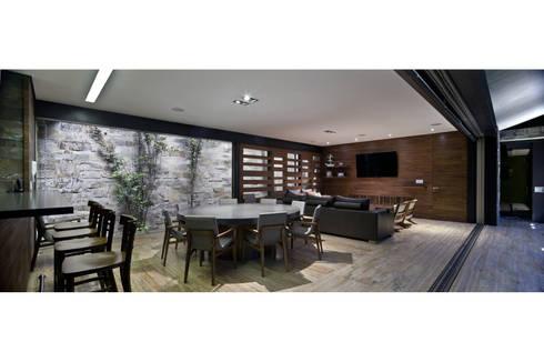 Salón ES: Jardines de estilo moderno por Cm2 Management