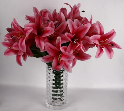 Dark Pink Lily bunches in a glass vase.:  Interior landscaping by Uberlyfe