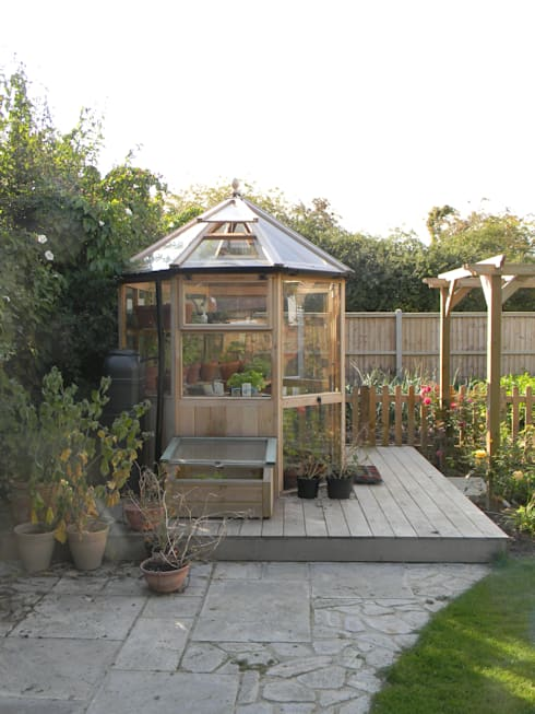 Smaller deck to surround new greenhouse.:   by Westacott Gardens