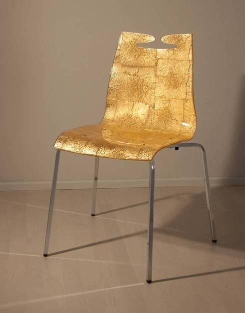 Arte Gold: Sala da pranzo in stile in stile Moderno di ABCDE sign