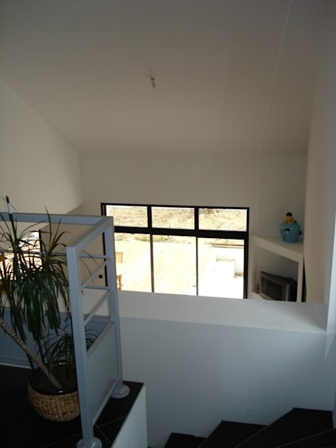 Maison à Vigneux De Bretagne 44: Couloir et hall d'entrée de style  par Archimat Creation