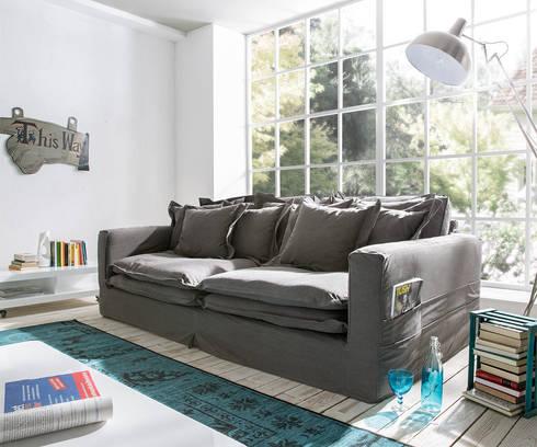 Salotto sofa: moderne Woonkamer door Asiades