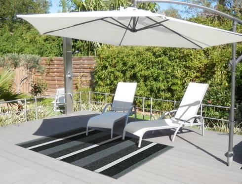 Des tapis pour colorer votre terrasse par itao homify - Comment disposer des pots sur une terrasse ...