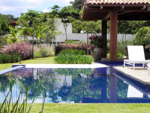Casa de campo: Jardins campestres por Catê Poli Paisagismo