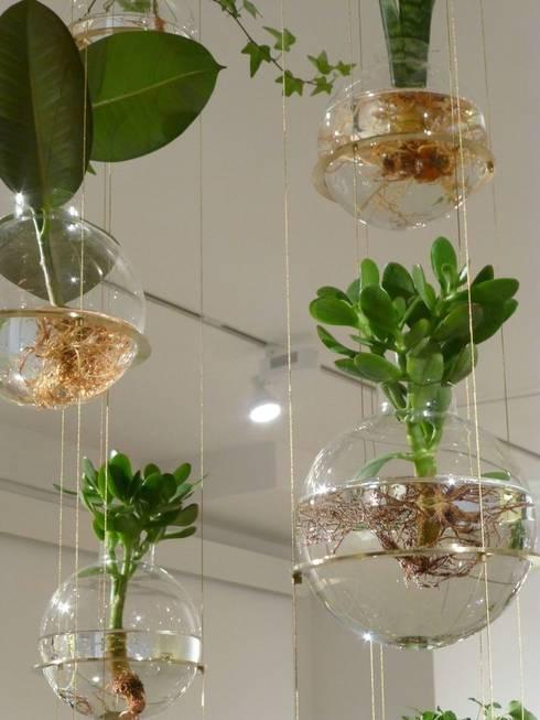 Bolle d'acqua: Soggiorno in stile in stile Eclettico di Dotto Francesco consulting Green