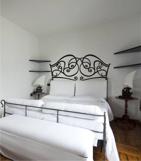 Dormitorios de estilo rústico por Visualvinilo