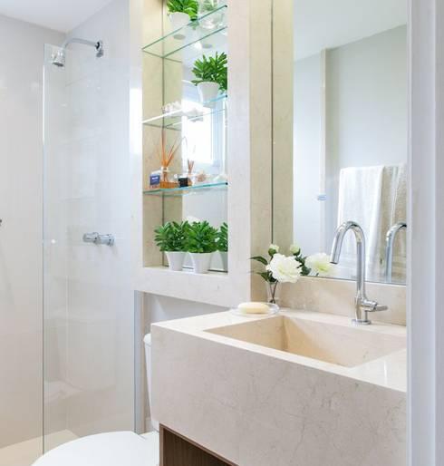 Santos | Decorados: Banheiros modernos por SESSO & DALANEZI