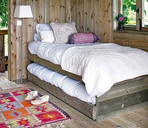 Ideas útiles para amueblar una habitación infantil compartida: Dormitorios de estilo rústico de MRN