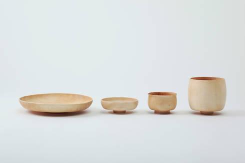 ナチュラル: KENICHIRO OOMORI MOVING DESIGNが手掛けたキッチンです。
