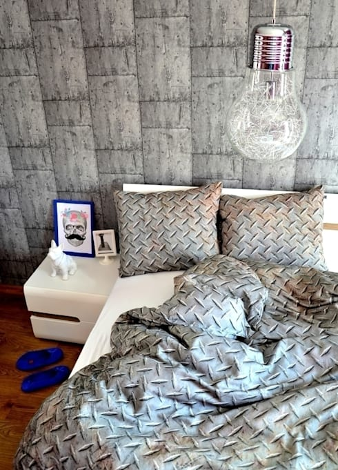 Camera da letto in stile in stile Industriale di HUG THE STUFF