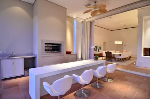 Casa Terra Ville I: Terraços  por Studio Cinque