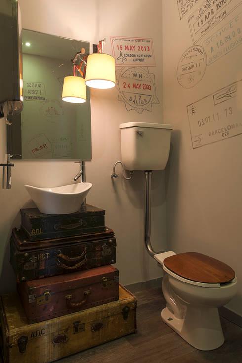 Departamento DL: Baños de estilo  por kababie arquitectos