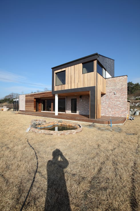 양평 회현리주택의 외관: 주택설계전문 디자인그룹 홈스타일토토의  주택
