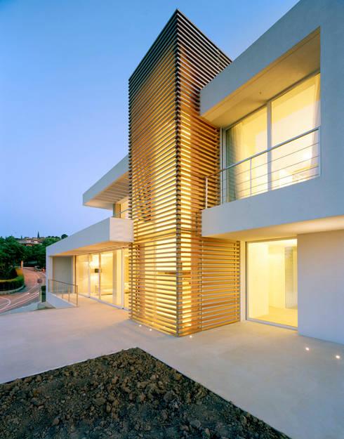 casa CMG: Case in stile in stile Moderno di Massimo Zanelli architetto