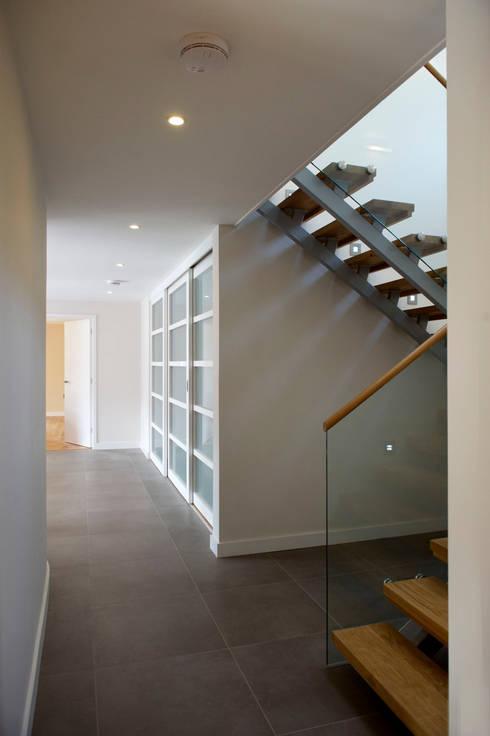 Grey Roofs, Crackington Haven, Cornwall:  Corridor & hallway by The Bazeley Partnership