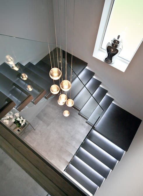 Floating tread staircase with glass balustrade:  Corridor & hallway by Railing London Ltd