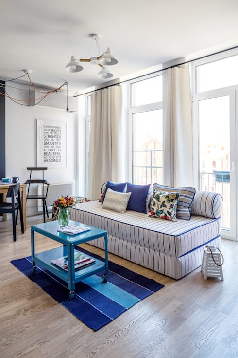 Проект однокомнатной квартиры-студии  40 м² : Гостиная в . Автор – SAZONOVA group