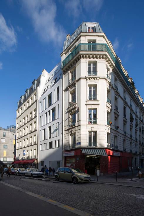 MAAST / RUE DES POISSONNIERS: Maisons de style  par maast