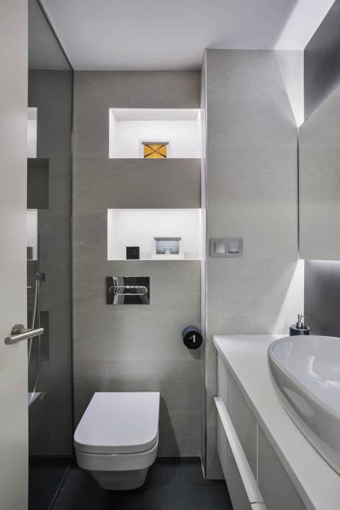 BAÑO L22: Baños de estilo moderno de Space Maker Studio