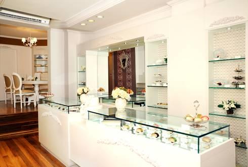 Loja de doces gourmet: Pavimentos  por Adriana Scartaris design e interiores