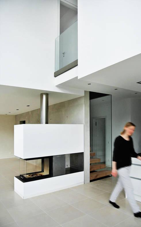 unlimited architekten  |  neumann + rodriguez의  거실