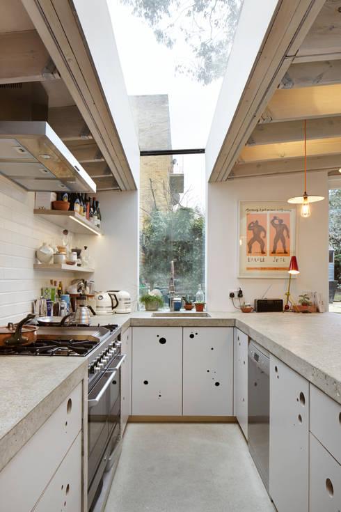 Wrap around window in the kitchen:  Kitchen by Fraher Architects Ltd