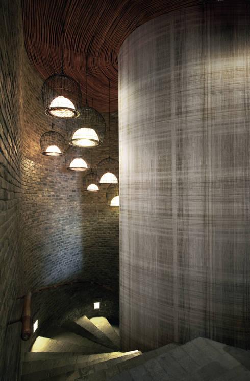 Paredes y pisos de estilo industrial por Tektura Wallcoverings