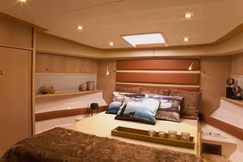 Barco 65 pés: Quartos  por unacasa arquitetura