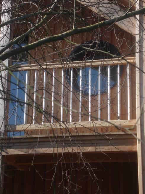 maison FOR: Terrasse de style  par Cécile Boerlen Architecte SARL