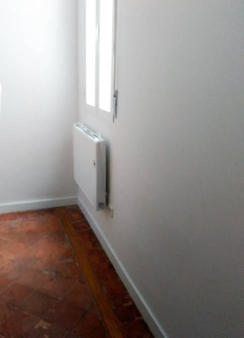 Después de la reforma. Vista habitación principal :  de estilo  de Arquigestiona Reformas S.L.