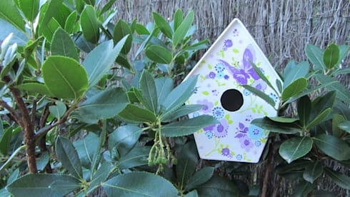Casita Pm - Mariposas moradas: Jardín de estilo  de Decupach