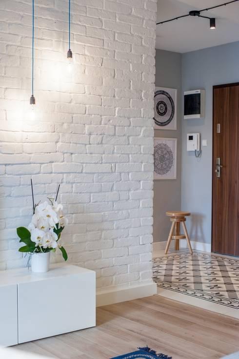 Gdańsk, Ul.Chmielna: styl , w kategorii Salon zaprojektowany przez Raca Architekci