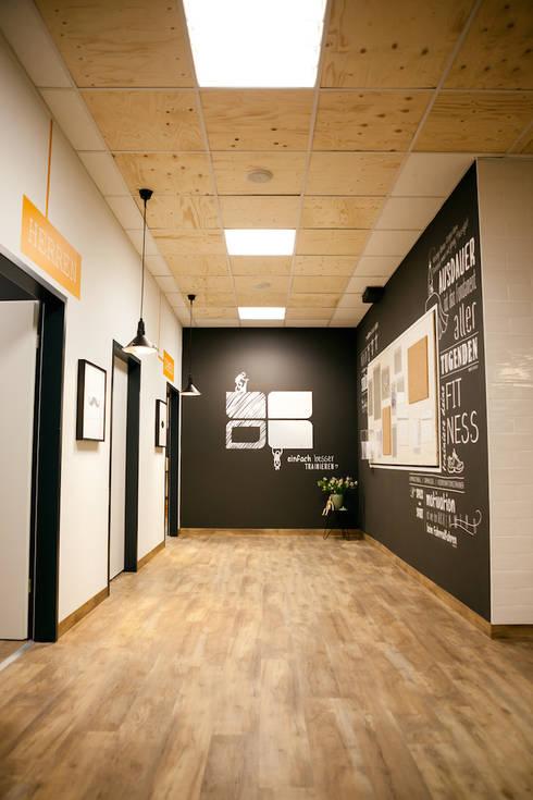 top sports fitness leinfelden deutschland von fifty fifty design homify. Black Bedroom Furniture Sets. Home Design Ideas