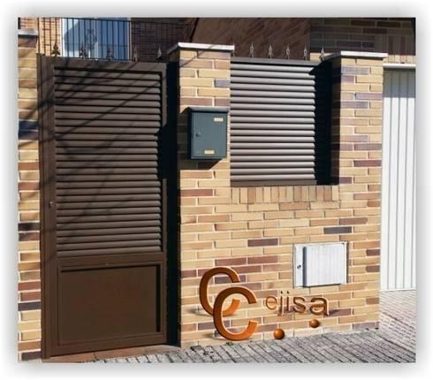 Puerta de lama elíptica: Ventanas de estilo  de Cerrajeria cejisa